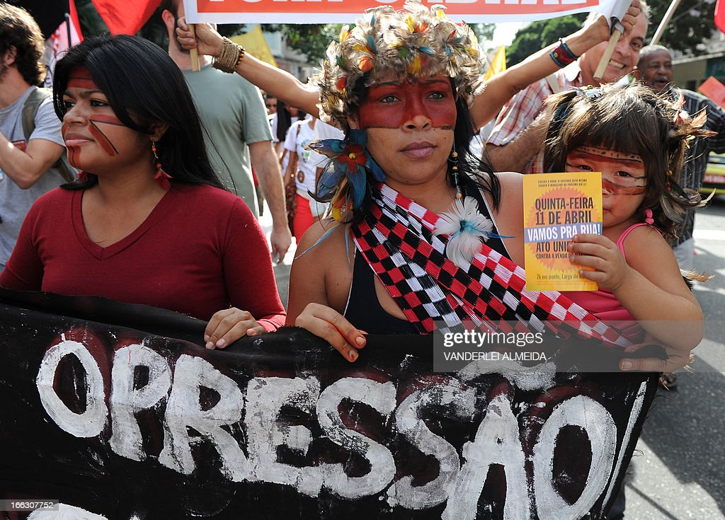 Activists --among them several native Brazilians-- protest in front of the Guanabara state government's palace against the privatization of the Mario Filho 'Maracana' stadium in Rio de Janeiro, Brazil, on April 11, 2013. Bidding for the privatization of Rio's iconic Maracana stadium was to go ahead as planned Thursday after a local court rejected an appeal to block the process. Maracana, which was built for the 1950 World Cup, is undergoing extensive renovation at a cost of 430 million dollars to host four Confederations Cup matches in June as well as seven World Cup games next year, including the finals of both tournaments.