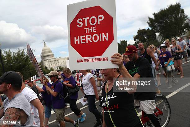 Activists and family members of loved ones who died in the opioid/heroin epidemic march in a 'Fed Up' rally at Capitol Hill on September 18 2016 in...