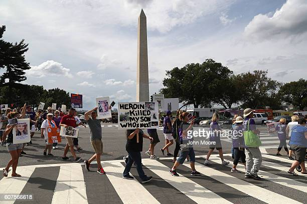 Activists and family members of loved ones who died in the opioid/heroin epidemic march in a 'Fed Up' rally on the National Mall on September 18 2016...