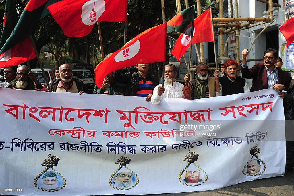 Activists and former freedom fighters who fought against Pakistan in the 1971 war demonstrate outside the International Crimes Tribunal court premises in Dhaka on January 21, 2013. Bangladesh's controversial war crimes court sentenced to death a top Islamic televangelists for genocide and other atrocities during the country's 1971 liberation struggle against Pakistan, a prosecutor said. Maolana Abul Kalam Azad who has been on the run for about a year is the first person to have been convicted by the controversial International Crimes Tribunal, created by the country's secular government to try suspected war criminals. AFP PHOTO/Munir uz ZAMAN
