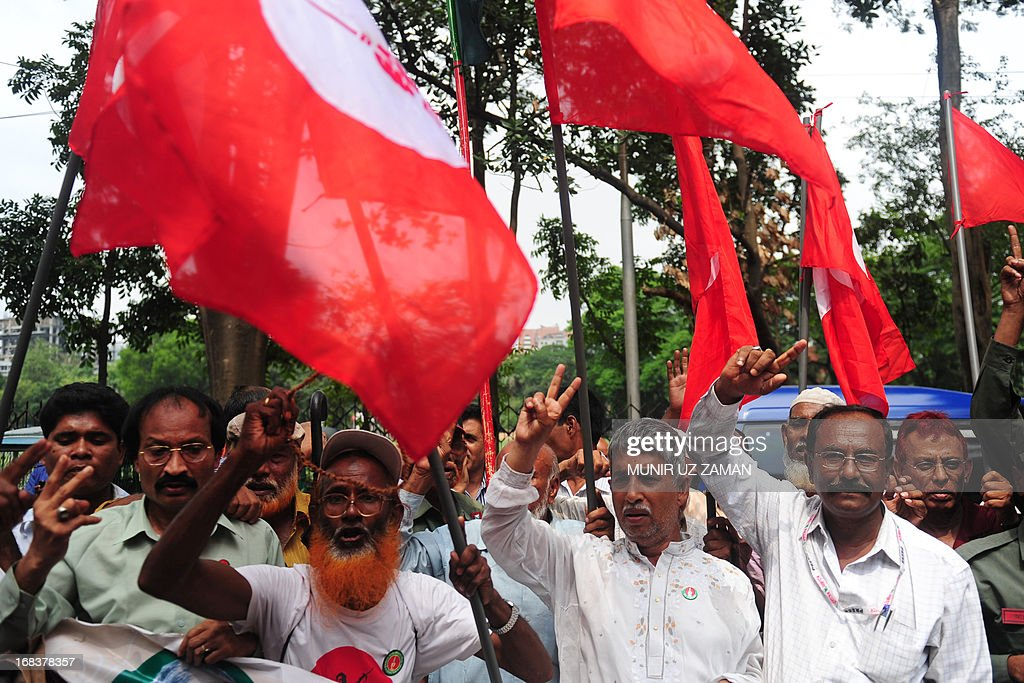 Activists and former freedom fighters who fought against Pakistan in the 1971 war demonstrate against the verdict on Mohammad Kamaruzzaman outside the International Crimes Tribunal court in Dhaka on May 9, 2013. Bangladesh's war crime court Thursday sentenced to death a senior figure in the country's largest Islamic party for war crimes such as genocide during the 1971 liberation struggle, the attorney general said. Mohammad Kamaruzzaman, 61, the assistant secretary general of the opposition Jamaat-e-Islami party, was the third leading opposition official to be sentenced by the much-criticised International Crimes Tribunal. AFP PHOTO/ Munir uz ZAMAN