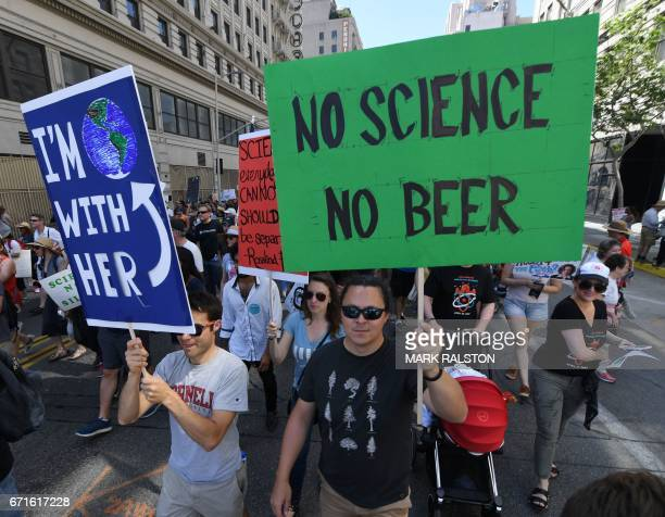 Activists and protesters march to City Hall during the March for Science in Los Angeles California on April 22 2017 Thousands of people joined a...