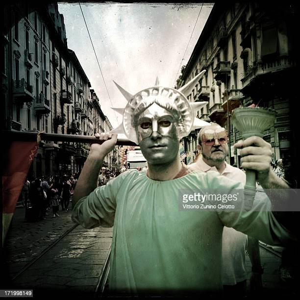 Activists and supporters of gay rights attend the annual Gay Pride parade on June 29 2013 in Milan Italy The parade is part of a World Pride Week and...