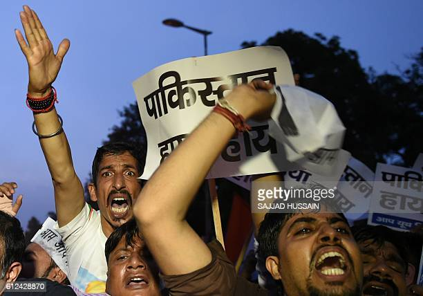 Activists and supporters of India's Aam Aadmi Party shout antiPakistani slogans during a protest as they try to march towards the Pakistani High...