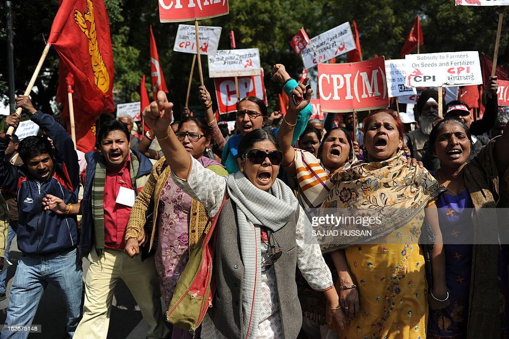 Activists and supporters of the Communist Party of India (Marxists) hold placards and banners as they shouts slogans during a protest demanding food security in New Delhi on February 26, 2013. Protestors demanded a universal public distribution system, a check on hoarding and black-marketing, an end to future trading and the passage of a food security bill with appropriate amendments to ensure ration to all citizens.