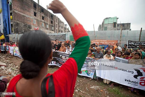 Activists and survivors of the Rana Plaza garment factory disaster demonstrate on the site where the building collapsed in Savar on the outskirts of...