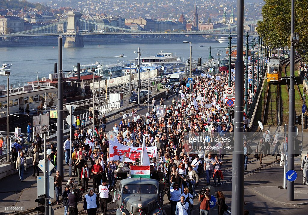 Activists and sympathizers of Hungarian 'Solidaritas' movement march on the bank of Danube River in Budapest's downtown during an anti-government demonstration organized by a civic organization 'One-million citizens for the press freedom' to protest against the Hungarian government's economy and financial policy, on October 23, 2012 during the 56th anniversary of Hungarian uprising and revolution. Tens of thousands of Hungarians were expected at rival political rallies in Budapest to be closely watched for signs of waning support for Prime Minister Viktor Orban and a strengthening opposition.
