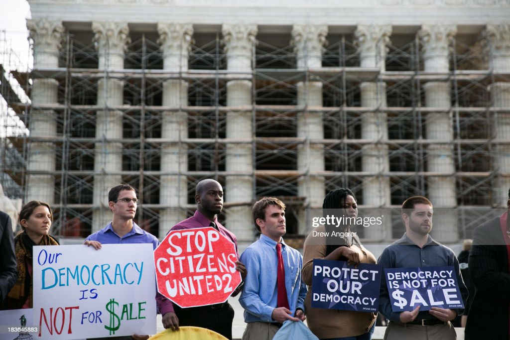 Activists are seen during a rally against money in politics, at the Supreme Court in Washington, on October 8, 2013 in Washington, DC. On Tuesday, the Supreme Court will hear oral arguments in McCutcheon v. Federal Election Committee, a first amendment case that will determine how much money an individual can contribute directly to political campaigns.