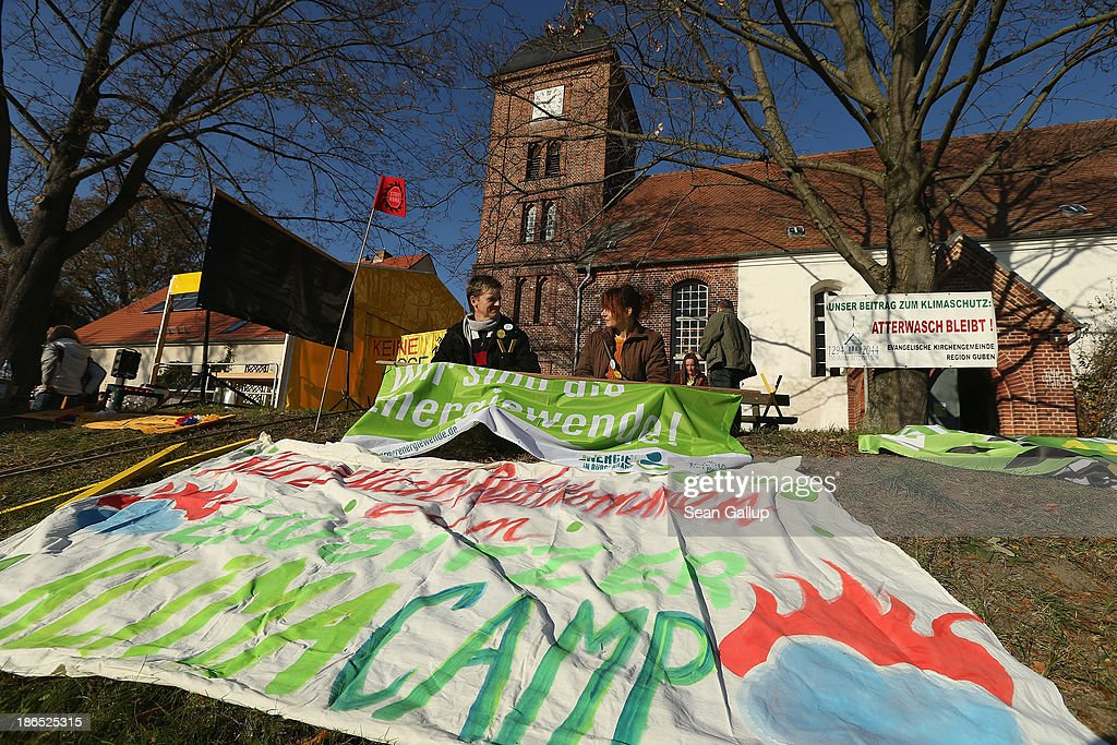 Activists attend a protest against the expansion of open-pit lignite coal mines at the annual village fest on October 31, 2013 in Atterwasch, Germany. According to plans by Swedish energy conglomerate Vattenfall and approved by the Brandenburg state legislature, Atterwasch and at least four other communities are to be raized and their inhabitants compensated and relocated in order to make way for the expansion of the mines. Energy policy and the role of coal is a heated topic at the moment in coalition negotiations between the Social Democrats (SPD) and Christian Democrats (CDU) currently taking place in Berlin.