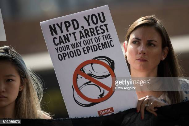 Activists attend a protest denouncing the city's 'inadequate and wrongheaded response' to the overdose crisis outside of the New York City Police...