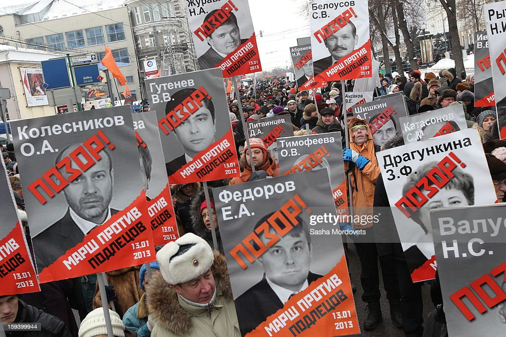 Activists attend an anti-Putin rally in central Moscow on January 13, 2012 in Moscow, Russia. Thousands of demonstrators gathered for a march to protest against a ban on Americans adopting Russian children.