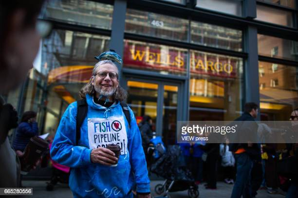 Activists begin the overnight camp out in front of Wells Fargo branch on April 5 2017 in Soho New York City Activists are looking to drive mayor Bill...