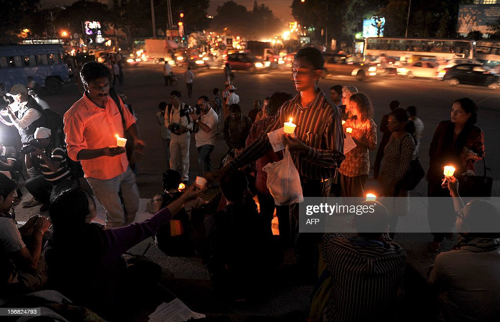 Activists belonging to the Coalition for Sexual Minority Rights (CSMR) take part in a candlelight vigil held as part of Transgender Day Remembrance held in Bangalore on November 22, 2012. The candle light vigil marks the start of the annual 10-day Bengaluru Pride and Karnataka Queer Habba 2012. AFP PHOTO/Manjunath KIRAN