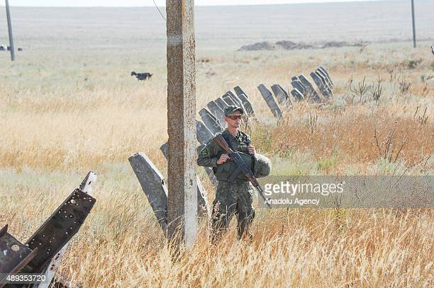 Activists block a road near to the border crossing point of Chonhar linking mainland Ukraine to Crimea on September 20 2015 Tatar activists on Sunday...