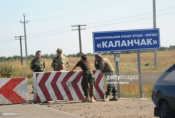 Activists block a road near to the border crossing point of Kalanchak linking mainland Ukraine to Crimea on September 20 2015 Tatar activists on...