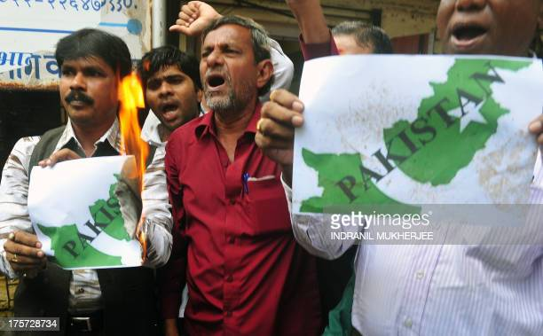 Activists burn a poster representing the map of Pakistan during a protest against the killing of 5 Indian soldiers in Kashmir in Mumbai on August 7...