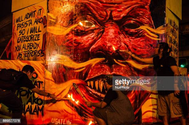 Activists burn an effigy of President Duterte depicts Duterte as a quotdemonquot during the International Human Rights Day protest in Manila...