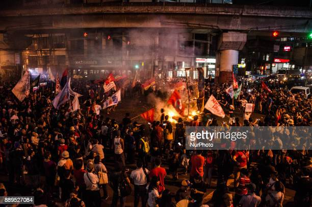 Activists burn an effigy of President Duterte during the International Human Rights Day protest in Manila Philippines on 10 December 2017 Thousands...