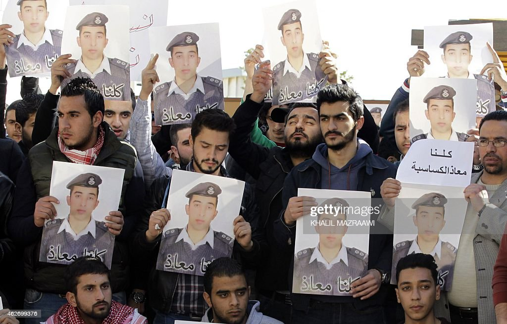 Activists carry posters with a portrait of the Jordanian pilot Maaz alKassasbeh who was captured by Islamic State group militants on December 24...
