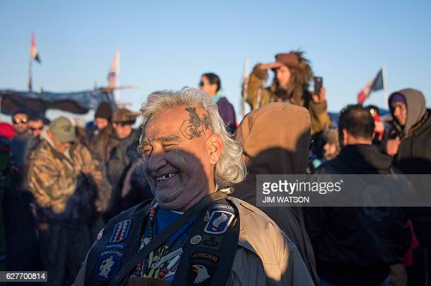 Activists celebrate at Oceti Sakowin Camp on the edge of the Standing Rock Sioux Reservation on December 4 2016 outside Cannon Ball North Dakota...