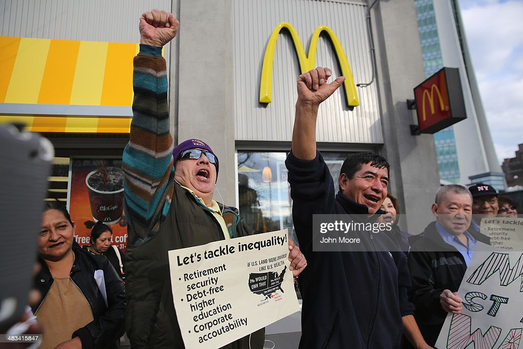 Activists chant for higher wages outside a McDonald's restaurant on April 8 2014 in Stamford Connecticut Demonstrations were organized across the...