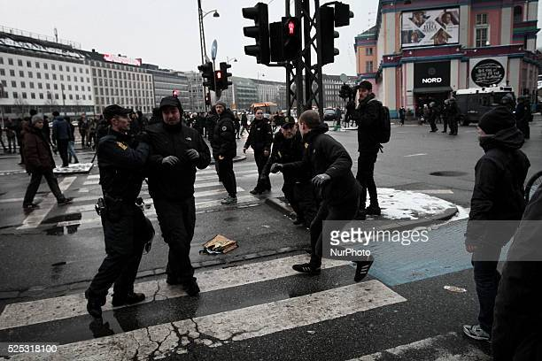 Activists clash with police officers Clashes between antiislamist protesters and antifascist activists broke out in Copenhagen Denmark on 23 January...