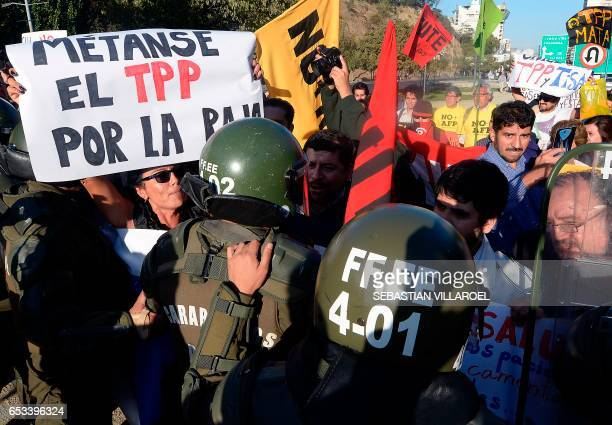 Activists confront carabiniere police during a protest against TTP treaties and the Pacific Alliance Ministers' Summit that takes place in Vina del...