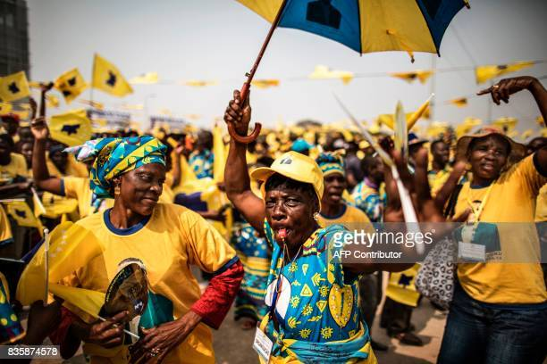 Activists dance as they gather ahead of the address of the leader of the Angolan opposition party CASACE Abel Chivukuvuku at an electoral rally in...