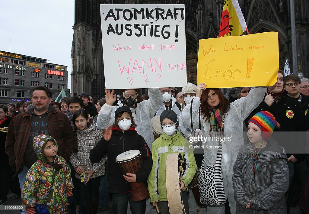 Activists demonstrate in the wake of the nuclear disaster at the Fukushima facility in Japan during an anti-nuclear demonstration at the Cologne cahedral plate on March 14, 2011 in Cologne, Germany. Thousands of anti-nuclear demonstrators gathered in a coordinated effort in cities across Germany to protest against the government-granted extension of the operational lives of Germany's older nuclear power plants. The debate over the safety of nuclear energy has been reignited worldwide following the earthquake and tsunami in Japan that severely damaged the Fukushima plant and where workers are desperately seeking to prevent a nuclear meltdown.