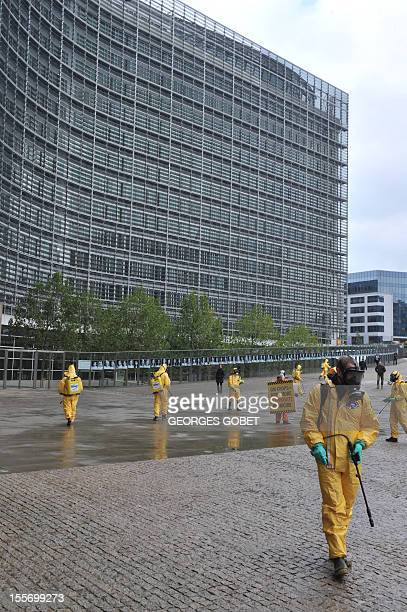Activists demonstrate outside the Commission headquarters on November 7 2012 at the EU headquarters in Brussels as the EU Commission is considering...