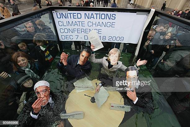 Activists dressed as leaders Abdoyale Wade of Senegal Barack Obama of the USA Angela Merkel of Germany and Hu Jintao of China pretend to debate in a...