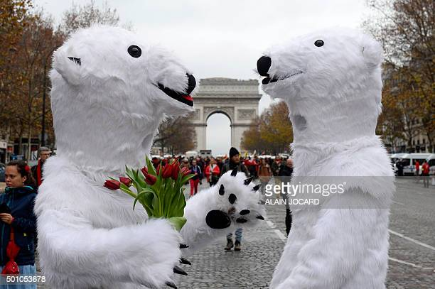 TOPSHOT Activists dressed as polar bears are pictured as activists gather for a demonstration to form a giant red line at the Avenue de la Grande...