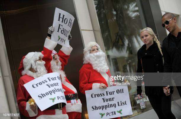 activists dressed as Santa Claus protest and chant antifur Christmas carols outside of the Michael Kors boutique on Rodeo Drive on December 15 2010...