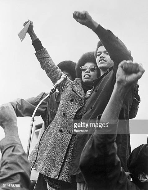 Activists Fania Jordan and Reginald Davis relatives of Angela Davis lead give the Black Power Salute at rally