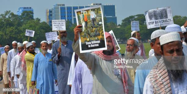 Activists from a Muslim group shout slogans during a protest rally against killings of Rohingya people