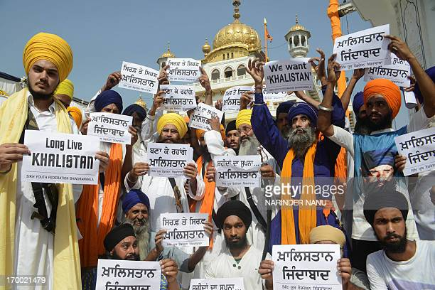 Activists from a radical Sikh organisation hold placards in support of Sikh leader Sant Jarnail Singh Bhindranwale and Khalistan the name given for...