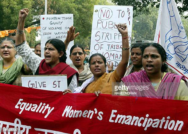 Activists from All India Democratic Women's Association shout antiCongressled Government slogans during a protest in New Delhi 27 November 2007...