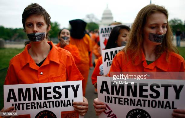 Activists from Amnesty International protest holding signs near the US Capitol on April 30 2009 in Washington DC The protesters were marking US...