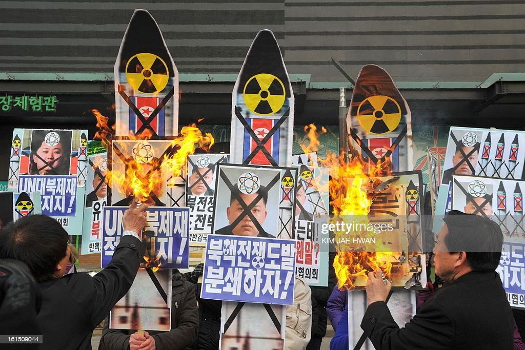 Activists from an anti-North Korea civic group burn placards of North Korean leader Kim Jong Un during a protest against North Korea nuclear test in Seoul on February 12, 2013. North Korea staged its most powerful nuclear test yet, claiming a breakthrough with a 'miniaturised' device in a striking act of defiance to global powers including its sole patron China.