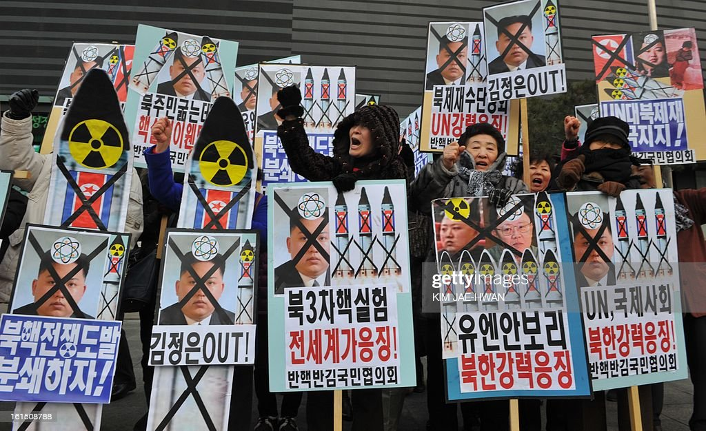 Activists from an anti-North Korea civic group shout slogans during a protest against North Korean nuclear test in Seoul on February 12, 2013.North Korea staged its most powerful nuclear test yet, claiming a breakthrough with a 'miniaturised' device in a striking act of defiance to global powers including its sole patron China..