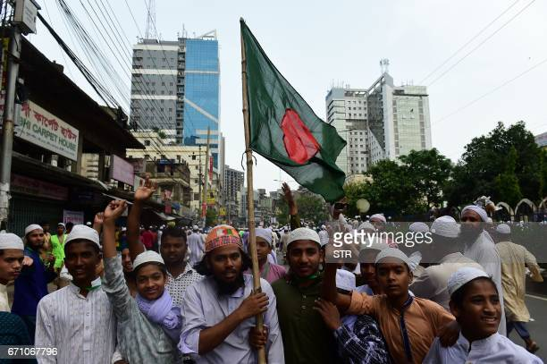 Activists from an Islamist group wave a flag as they take part in a protest in Dhaka on April 21 which calls for the removal of a statue in front of...