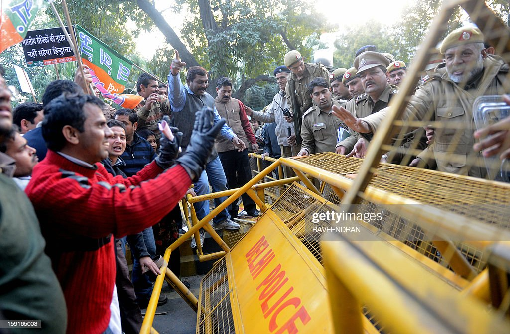 Activists from India's main opposition Bharatiya Janata Party (BJP) argue with police during a protest march to the Pakistani embassy, against the killing of Indian soldiers Lance Naik Hemraj and Sudhakar Singh in the disputed Kashmir region, in New Delhi on January 9, 2012. India summoned Pakistan's envoy in New Delhi to protest the killing of two soldiers in a border clash, but warned against any escalation, after apparent tit-for-tat skirmishes that have led to deaths on both sides. Two Indian soldiers died after a firefight erupted in disputed Kashmir on Tuesday as a patrol moving in fog discovered Pakistani troops about 500 metres (yards) inside Indian territory, according to the Indian army.