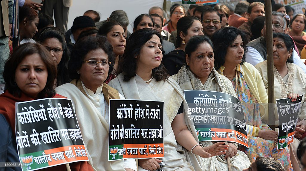 Activists from India's main opposition Bharatiya Janata Party (BJP) hold placards as they demand Indian Home Minister Sushilkumar Shinde's resignation for alleging that the BJP and The Rashtriya Swayamsevak Sangh (RSS) were behind attacks on non-Hindus during a protest in New Delhi on January 27, 2013. BJP leaders have demanded the resignation of Shinde for the comments and they want an apology from the congress led government.