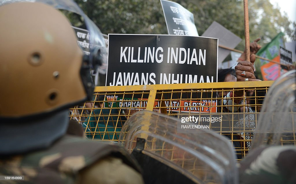 Activists from India's main opposition Bharatiya Janata Party (BJP) hold up placards during a protest march to the Pakistani embassy, against the killing of Indian soldiers Lance Naik Hemraj and Sudhakar Singh in the disputed Kashmir region, in New Delhi on January 9, 2012. India summoned Pakistan's envoy in New Delhi to protest the killing of two soldiers in a border clash, but warned against any escalation, after apparent tit-for-tat skirmishes that have led to deaths on both sides. Two Indian soldiers died after a firefight erupted in disputed Kashmir on Tuesday as a patrol moving in fog discovered Pakistani troops about 500 metres (yards) inside Indian territory, according to the Indian army.
