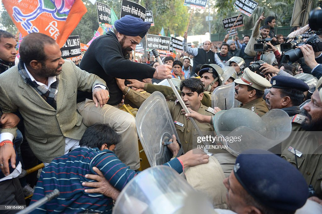 Activists from India's main opposition Bharatiya Janata Party (BJP) shout anti-Pakistan slogans as they jump a police barricade during a protest march to the Pakistani embassy, against the killing of Indian soldiers Lance Naik Hemraj and Sudhakar Singh in the disputed Kashmir region, in New Delhi on January 9, 2012. India summoned Pakistan's envoy in New Delhi to protest the killing of two soldiers in a border clash, but warned against any escalation, after apparent tit-for-tat skirmishes that have led to deaths on both sides. Two Indian soldiers died after a firefight erupted in disputed Kashmir on Tuesday as a patrol moving in fog discovered Pakistani troops about 500 metres (yards) inside Indian territory, according to the Indian army. AFP PHOTO/RAVEENDRAN