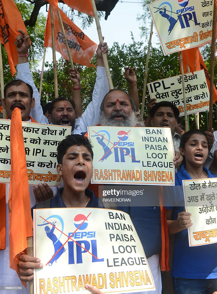 Activists from India's Rashtrawadi Shiv Sena shout slogans as they demand the banning of the Indian Premier League (IPL) Twenty20 cricket tournament during a protest in New Delhi on May 17, 2013. Indian police said that they had arrested three cricketers including Test bowler Shanthakumaran Sreesanth, after they allegedly accepted tens of thousands of dollars for spot-fixing. Eleven bookmakers were also arrested in connection with the inquiry, said Delhi Police Commissioner Neeraj Kumar, as he gave details of three games in the ongoing tournament at the centre of the corruption probe.