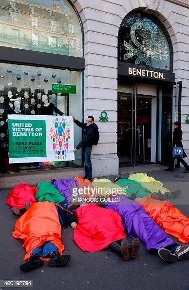 Activists from lobby group 'Peuples Solidaires' and the 'Ethique sur l'etiquette' collective perform a protest in front of the Benetton retailing...