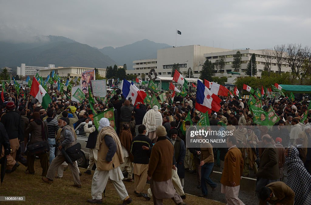Activists from Pakistan's opposition parties gather in front of parliament house during a protest in Islamabad on February 4, 2013. Hundreds of demonstrators participated in a rally from Parliament House to the offices of the nearby Election Commission of Pakistan (ECP), to express solidarity with the ECP and demand its empowerment to ensure free and fair general elections. AFP PHOTO/Farooq NAEEM
