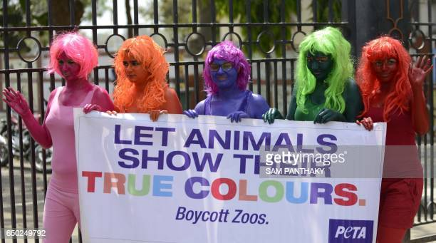 Activists from People for the Ethical Treatment of Animals India stage a demonstration outside Kankaria Lake Front in Ahmedabad on March 9 in the...