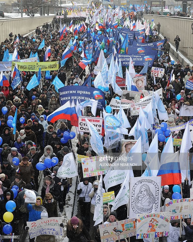 Activists from pro-Kremlin children's advocacy groups march through Moscow on March 2, 2013 to call on authorities to ban all foreign adoptions and demand the return of an adopted boy whose brother died in Texas.